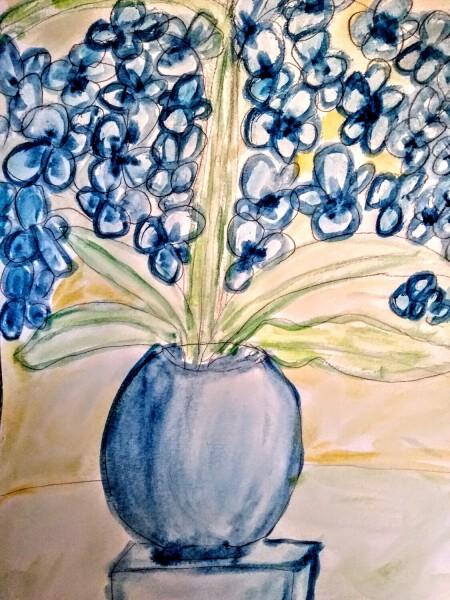 Kwiat w niebieskim wazonie